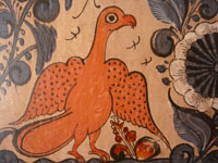 Closeup photo of Tlaquepaque tile with eagle
