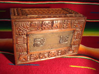 Mexican vintage wood-carving and Mexican vintage folk art, a wooden box beautifully carved with Mayan faces and designs, c. 1930-40. The top of the box bears a silver plaque with wonderful Mayan symbols or faces. Silver plaque and top of the box.