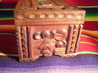 Mexican vintage wood-carving and Mexican vintage folk art, a wooden box beautifully carved with Mayan faces and designs, c. 1930-40. The top of the box bears a silver plaque with wonderful Mayan symbols or faces. Photo showing one side of the box.