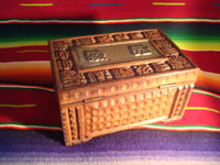 Mexican vintage wood-carving and Mexican vintage folk art, a wooden box beautifully carved with Mayan faces and designs, c. 1930-40. The top of the box bears a silver plaque with wonderful Mayan symbols or faces. Another view of the box.
