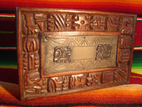 Mexican vintage wood-carving and Mexican vintage folk art, a wooden box beautifully carved with Mayan faces and designs, c. 1930-40. The top of the box bears a silver plaque with wonderful Mayan symbols or faces. Closeup of the top of the box.