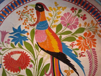 Mexican vintage wood-carving and laquer-ware art, a wonderful batella from Uruapan, Michoacan, c. 1930's. The large batella is decorated with an exquisite exotic bird with a lovely long tail, perhaps the famed quetzal. A closeup of the lovely bird.