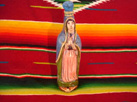 Mexican vintage pottery and ceramics, and Mexican vintage folk art, a holy water bottle depicting Our Lady of Guadalupe, Tlaquepaque, c. 1930-40. The bottle bears the early stamp of the Arias store in Tlaquepaque.