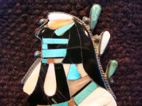 Native American Indian vintage silver jewelry, a Zuni broach with inlay, c. 1940. Closeup photo of the head of the Naja.