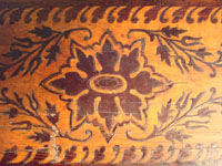 Mexican vintage wood-carving, a marquetry box with beautiful inlaid wood designs from Oaxaca, c. 1890. A closeup photo of the top of the marquetry box.