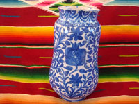 Mexican vintage pottery and ceramics, a Talavera vase from Puebla, c. 1940. Beautiful blue designs of the double-headed Hapsburg eagle, a wonderful plant with a flower, and a beautiful pomegranate (granada). Another side of vase.