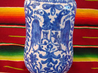 Mexican vintage pottery and ceramics, a Talavera vase from Puebla, c. 1940. Beautiful blue designs of the double-headed Hapsburg eagle, a wonderful plant with a flower, and a beautiful pomegranate (granada). A closeup of the double-headed eagle.