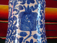 Mexican vintage pottery and ceramics, a Talavera vase from Puebla, c. 1940. Beautiful blue designs of the double-headed Hapsburg eagle, a wonderful plant with a flower, and a beautiful pomegranate (granada). A view of the pomegranate on the vase.