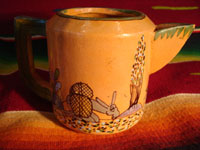 Mexican vintage pottery and ceramics, a teapot and creamer set from Tlaquepaque, c. 1930-40. Closeup photo from the creamer.