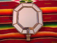 Mexican vintage tin-art (tinwork art), an octagonal tinwork mirror with a single candleholder at the base, c. 1930-40. Another view of the front side of the mirror.