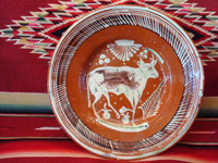 Mexican vintage pottery and ceramics, a bandera-ware charger with a wonderful bull, Tonala or Tlaquepaque, Jalisco, c. 1930's. The charger is decorated with the colors of the Mexican flag (bandera, in Spanish), white, green, and red. Main photo of the charger.