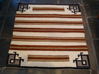Native American Indian textiles and Navajo rugs, a Navajo saddle blanket with a wonderful decorative pattern, c. 1950's. The saddle blanket is finely woven. Main photo of the Navajo saddle blanket.