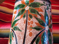 Mexican vintage pottery and ceramics. a lovely petatillo pitcher with a handle and very fine hand-painted decoration, Tlaquepaque, Jalisco, c. 1940's. Photo showing a lovely plant and flower on the pitcher.