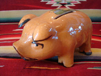 Mexican vintage pottery and ceramics and Mexican vintage folk art, a pottery piggy bank with lovely artwork on its back, from Tlaquepaque, Jalisco, c. 1930's. This is a great piece of Mexican vintage folk art and a collector's dream. Main photo of the pottery piggy bank.