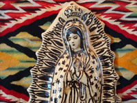 Mexican pottery and ceramics, and Mexican devotional art, a very lovely image of Our Lady of Guadalupe, done in the traditional style and colors of Tzintzuntzan, Michoacan, c. 1990's. Closeup photo of Our Lady's face.