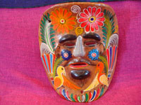 Mexican vintage pottery, and Mexican vintage folk-art, a pair of wonderful pottery masks from Amayaltepec, Guerrero, c. 1950's. Closeup photo of one of the masks.