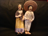 Mexican vintage folk-art, a pair of Mexican dolls made from canvass cloth and wonderfully clothed in traditional Mexican costumes, c. 1940's.  Main photo of the dolls.