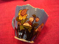 Mexican vintage pottery and ceramics, a lovely blue-ware dish shaped like two leaves, and with room for one cup, Tlaquepaque or Tonala, Jalisco, c. 1920-30's. Photo of one side of the cup.