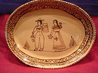 Mexican vintage pottery and ceramics, a lovely oval charger with a wonderful scene of a family near Lake Patzcuaro, in the traditional style of the village of Tzintzuntzan, Michoacan, c. 1950's.  Main photo of the platter.