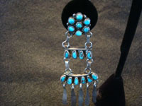 Native American Indian vintage silver jewelry, and Navajo vintage sterling silver jewelry, a stunning pair of chandelier-style silver earrings with turquoise stones, Navajo, c. 1930's. Closeup photo of one of the Navajo silver earrings.