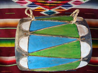 Native American Indian vintage folk art, a wonderful Pueblo dance drum, decorated with vivid designs and colors, Pueblos of New Mexico, c. 1950's. Photo of the drum lying on its side and showing both ends of the dance drum.