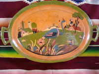 Mexican vintage pottery and ceramics, a pottery oval charger with very fine and detailed artwork, Tonala or Tlaquepaque, Jalisco, c. 1930's.  Main photo of the oval charger or bowl.