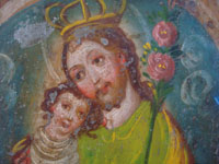 Mexican vintage devotional art, and Mexican vintage tinwork art, a lovely tinwork-art retablo depicting St. Joseph with the child Jesus, c. 1920. Closeup view of the faces of St. Joseph and the child Jesus on the Mexican tin retablo.