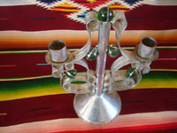 BU-3: Mexican vintage tinwork art, and Mexican vintage folk art, a lovely tinwork-art candlelabra with five green glass spheres as decorations, Oaxaca, c. 1940's. Photo looking down at the top of the candlelabra.