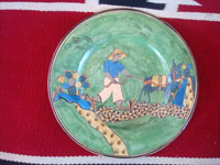 Mexican vintage pottery and ceramics, a beautiful plate with wonderful artwork decorations and an endearing scene of a campesino going to work accompanied by his loyal blue burro, attributed to the great Balbino Lucano, Tonala or San Pedro Tlaquepaque, c. 1930's.  Main photo of the plate.