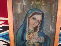 Mexican vintage devotional art, and Mexican vintage tinwork art, a lovely retablo painted on tin, depicting the Dolorosa (Sorrowful Mother), c. 1930. Closeup photo of our Lady's face.