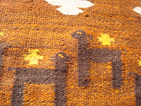 Mexican vintage textiles and serapes, a beautiful, hand-woven textile or rug with wonderful colors and design elements, c. 1940's. Closeup photo of part of the textile, showing the sheep and crosses.