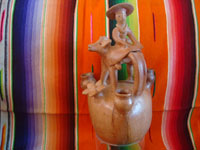 Mexican vintage folk art, and Mexican vintage pottery and ceramics, a candlelabra in the form of a lovely woman riding atop her steer, attributed to the great Heron Matinez during his burnished natural period, Acatlan, Puebla, c. 1950's. Main photo of the Heron Martinez piece.