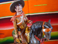 Mexican vintage folk art, and Mexican vintage pottery and ceramics, a pottery sculpture depicting a Mexican revolutionary, perhaps Emiliano Zapata or Pancho Villa, riding a beautiful horse, attributerd to the great Panduro family of sculptors, San Pedro Tlaquepaque, c. 1930's. Closeup photo of the rider's face.