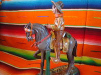 Mexican vintage folk art, and Mexican vintage pottery and ceramics, a pottery sculpture depicting a Mexican revolutionary, perhaps Emiliano Zapata or Pancho Villa, riding a beautiful horse, attributerd to the great Panduro family of sculptors, San Pedro Tlaquepaque, c. 1930's. Photo showing the second side of the horse and rider.
