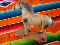 Mexican vintage folk art, a wonderful paper mache toy horse with wooden wheels, Mexico, 1937. Main photo of the horse.