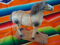 Mexican vintage folk art, a wonderful paper mache toy horse with wooden wheels, Mexico, 1937. Photo of the second side of the toy horse.