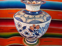 Mexican vintage pottery and ceramics, a spectacular pottery vase or urn with a cream-colored background, fantastic artwork, and covered with tiny stars, Tonala or San Pedro Tlaquepaque, c. 1920-30's.  Side view of another part of the vase.