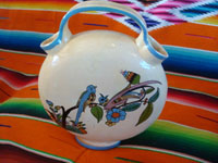 Mexican vintage pottery and ceramics, a beautiful canteen-like vase, often referred to as a wedding vase, San Pedro Tlaquepaque or Tonala, Jalisco, c. 1940's. Main photo of one side of the vase.