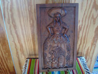 "Mexican vintage woodcarvings and masks, a very wonderful wood-carved bas-relief, unsigned, featuring a beautiful ""China Poblana"" in traditional dress, c. 1940's. Main photo of the carving."