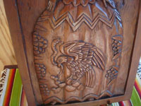 "Mexican vintage woodcarvings and masks, a very wonderful wood-carved bas-relief, unsigned, featuring a beautiful ""China Poblana"" in traditional dress, c. 1940's. Photo of the lower part of the carving showing the woman's skirt with the Mexican eagle."