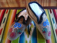 Native American Indian vintage beadwork, and vintage folk art, a beautiful pair of Cree child's mocassins with very fine and colorful beadwork, c. 1920's or earlier. Main photo of the pair of Cree beaded mocassins.