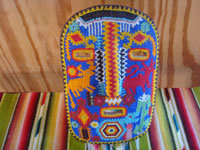 Mexican vintage folk art, and Mexican vintage woodcarvings and masks, a beautifully beaded wood-carved Huichol mask, Jalisco, c. 1980. Main photo of the beaded mask.