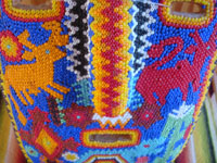 Mexican vintage folk art, and Mexican vintage woodcarvings and masks, a beautifully beaded wood-carved Huichol mask, Jalisco, c. 1980.  Closeup photo of a part of the beaded Huichol mask.