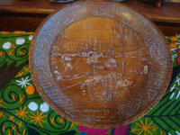 Mexican vintage folk art, and Mexican vintage woodcarvings and masks, a wonderful hand-adzed wooden plate with fine carving and pyro art, Michoacan, c. 1940's. Main photo of the plate.