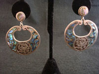 Mexican vintage silver jewelry, Taxco sterling silver earrings with abalone shell inlay and an Aztec design, c. 1940's.