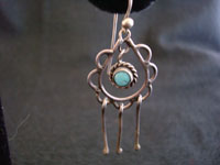 Closeup photo of Native American Indian silver jewelry, Navajo earrings with turquoise.
