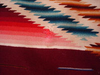 Mexican vintage textiles, a Saltillo sarape, c. 1940. Beautiful burgundy background. Made of very finely woven wool with silk in the center medallion and decorative side-bars.  Another closeup photo.