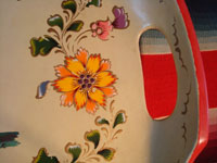 Mexican vintage wood-carving and Mexican vintage folk art, a laquer-ware tray from Olinala, c. 1940's. The tray features two old men with canes in the center, surrounded by flowers and a wonderful red rim. Another closeup.