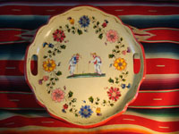 Mexican vintage wood-carving and Mexican vintage folk art, a laquer-ware tray from Olinala, c. 1940's. The tray features two old men with canes in the center, surrounded by flowers and a wonderful red rim. Main photo.