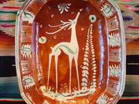 Mexican vintage pottery and ceramics, a lovely oval dish, bandera-ware (the colors of the Mexican flag or bandera), decorated with a graceful deer and cypress tree, Tlaquepaque, c. 1930-40's. Closeup photo of the deer on the front of the plate.